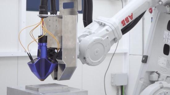 """""""Meltio Engine"""" ant robotinės rankos. © Gamintojo nuotrauka"""